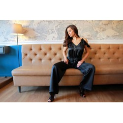 Jumpsuit in black with belt and frils